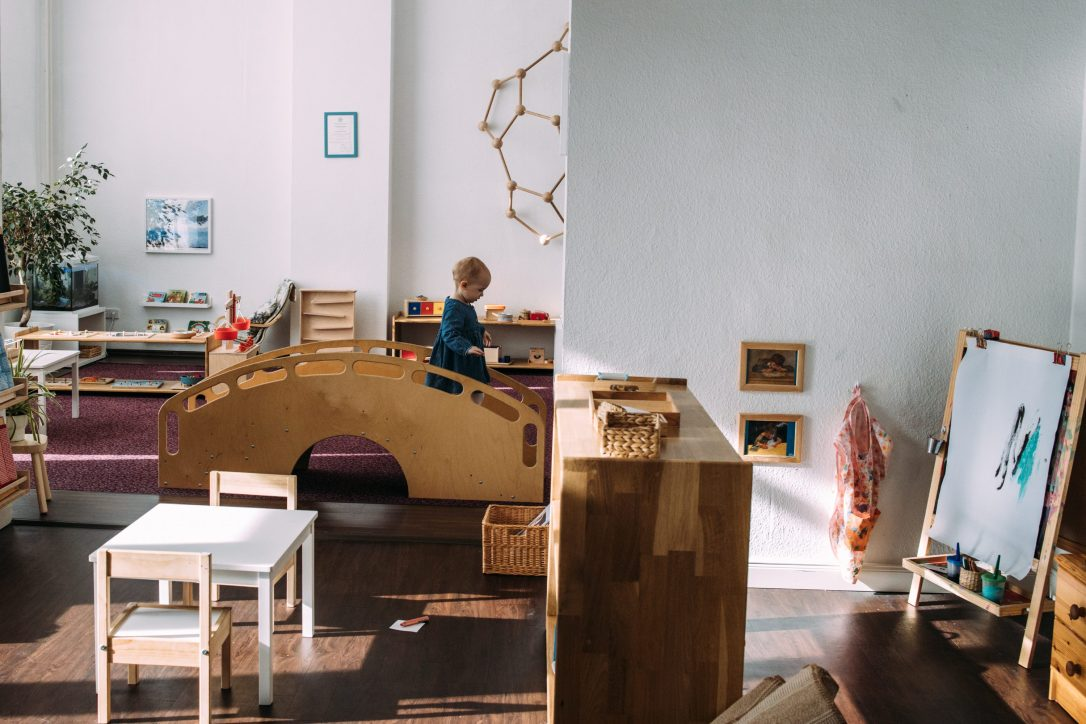 montessori toddler classroom, wooden staircase, art area, montessori table and chairs, toddler environment, infant community, shelfie, berlin montessori school