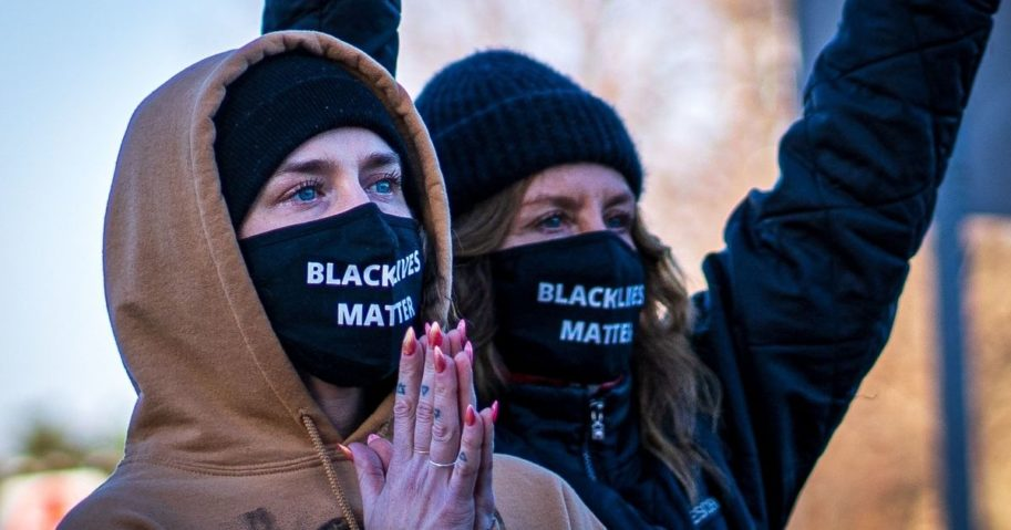 "Two women wearing ""Black Lives Matter"" masks participate in the ""Justice for George Floyd"" march to the Minnesota State Capitol on March 19, 2021, in Saint Paul, Minnesota"