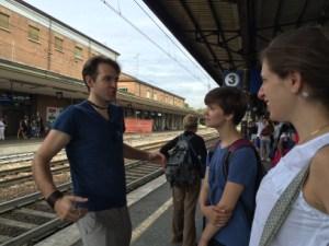 Waiting for the train Jeannine (USA), Jason (Australia) and Sophie (England), Reggio Emilia, Photo: Julie Santini
