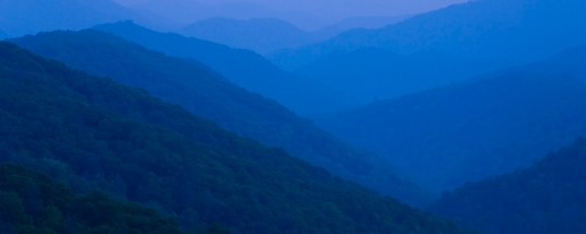 View from Newfound Gap after sunset with layered mountains