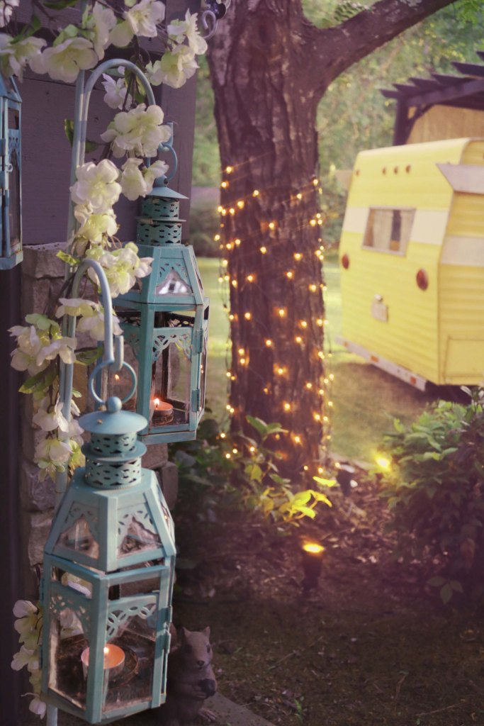 Glamping inspiration: Lanterns in the forest.