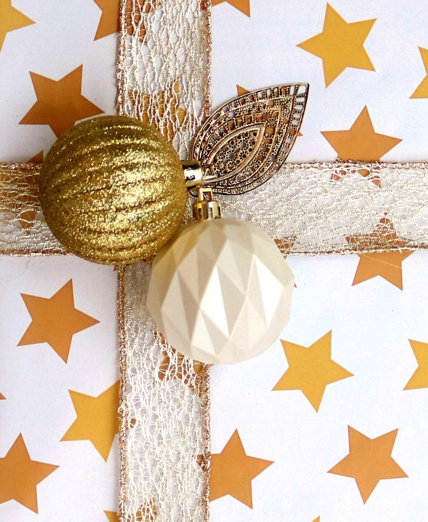 Upcycle old Christmas or Yule ornaments to create gorgeous accents on presents.