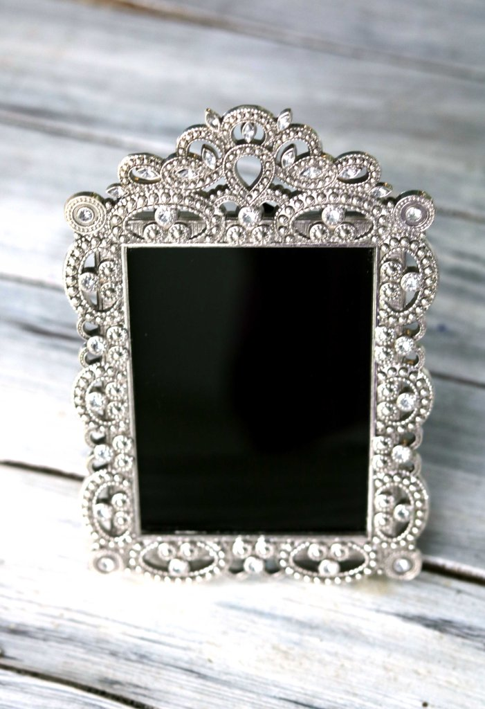 Black miniture scrying mirror. Perfect for travel altars or very small ritual spaces.