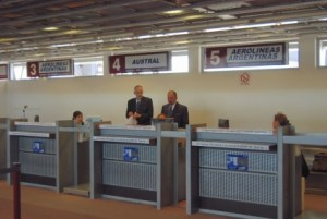 Staff stand at the Aerolíneas check-in counter.