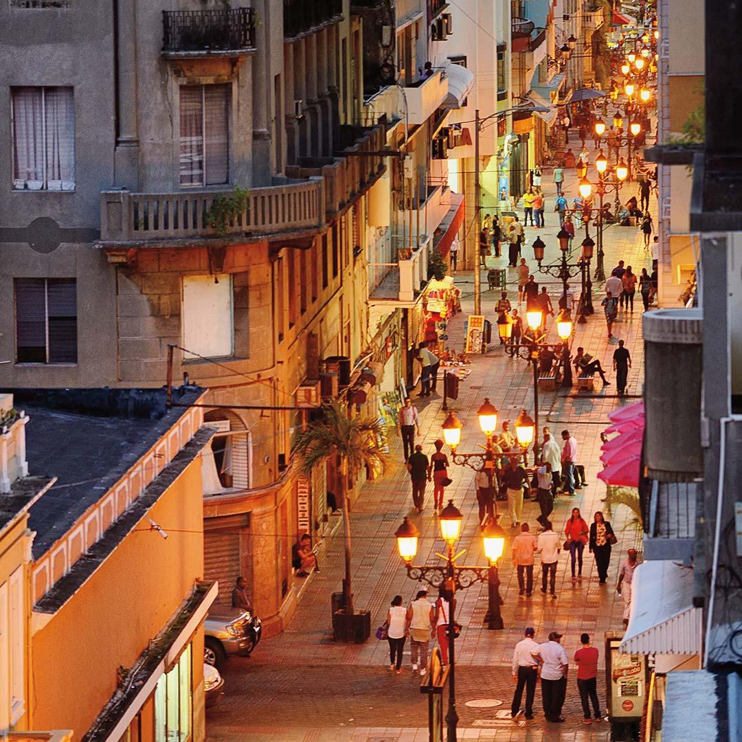 people walking on Calle El Conde at night