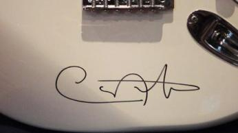 Detail of White Fender Stratocaster signed by Carlos Santana.