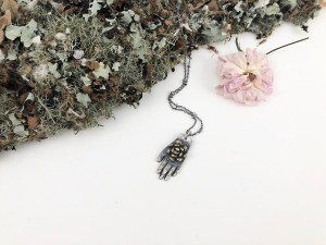 Hand with Flower Necklace