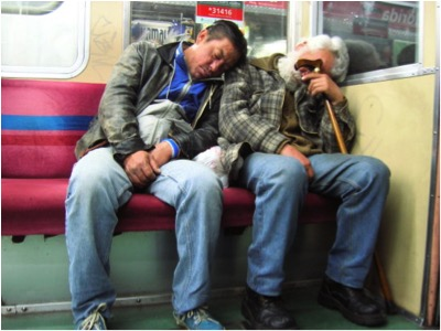 MEN ASLEEP ON SUBWAY