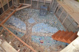 photo of floor mosaic of tree and water under construction