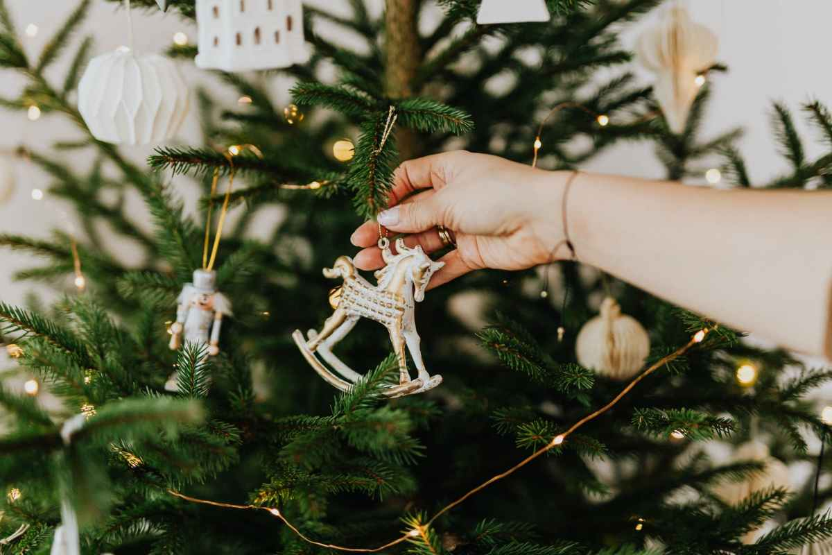 person holding rocking horse christmas ornament