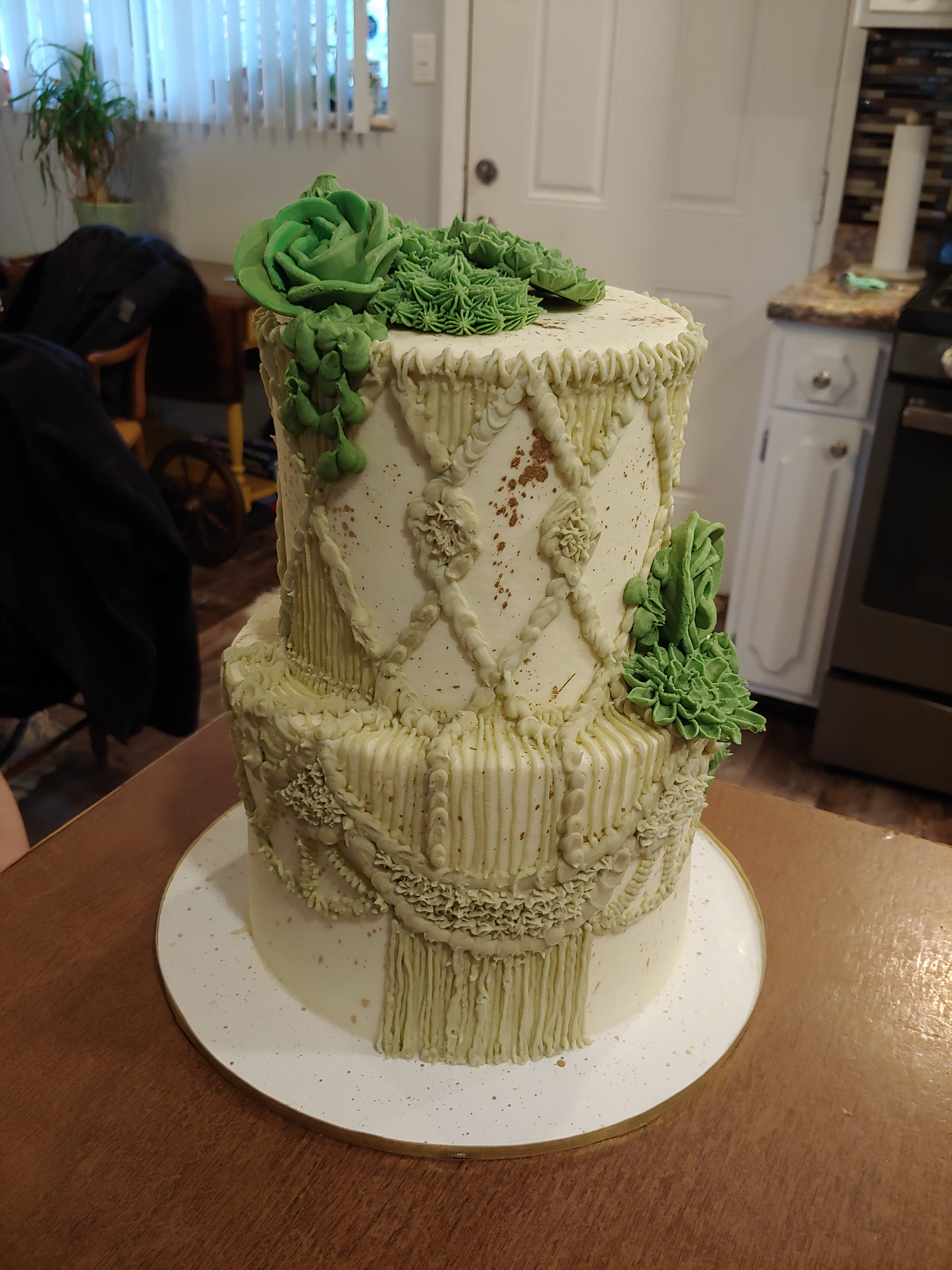 A macramé cake with fondant and icing succulents