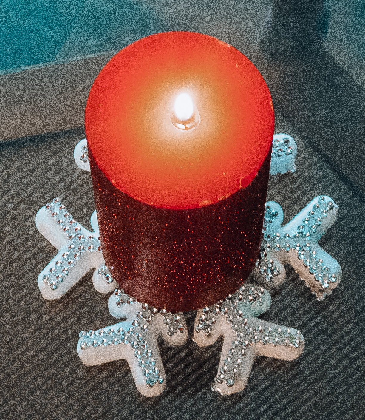 Red candle with snowflake coaster