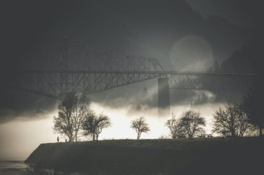 Empty bridge in the night surrounded by fog