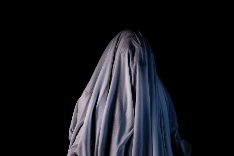 Ghost: White sheet on black background Haunted Paranormal