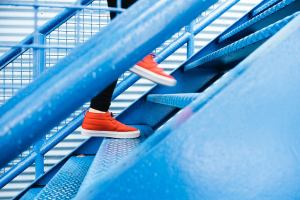 How to Climb Stairs Pain Free - Moon Physical Therapy - Featured Image