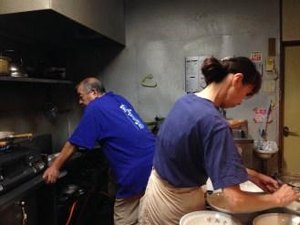 A cute couple making us the local fish-broth ramen