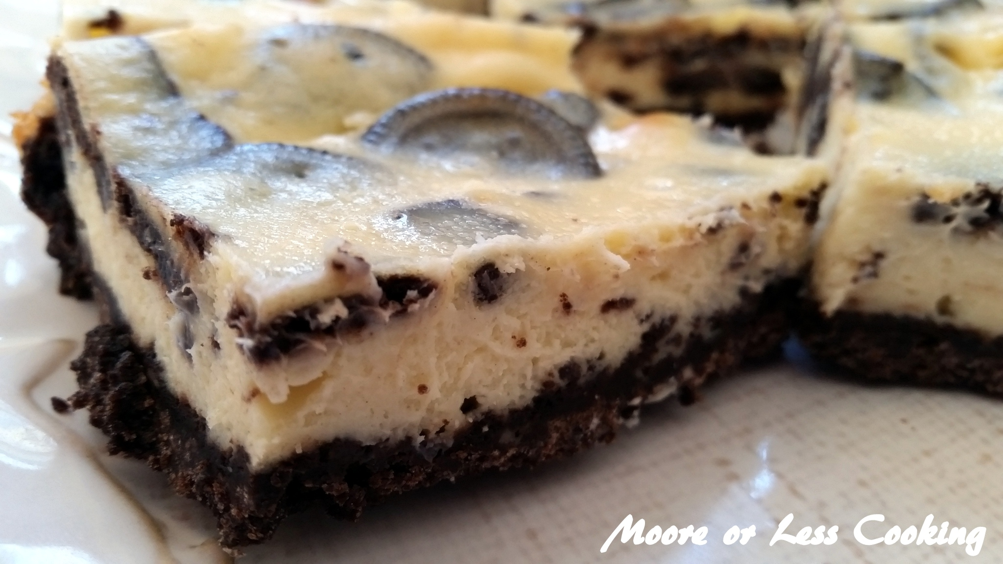 creamy cheesecake with chunks of cookies and a cookie crust