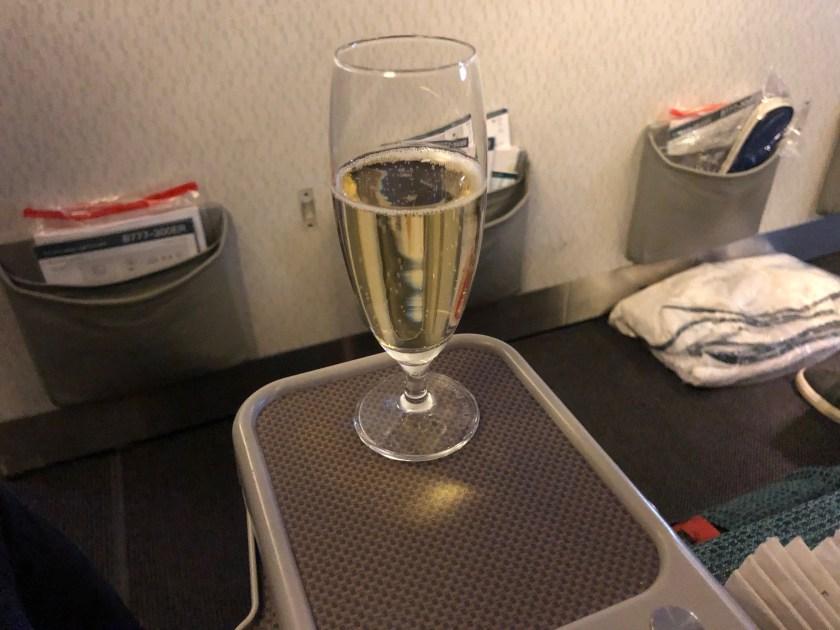 Cathay Pacific 777 Premium Economy Pre-Departure Champagne