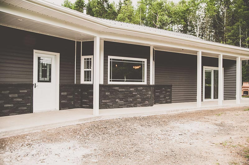 Custom home with stone and siding in Howard Brook