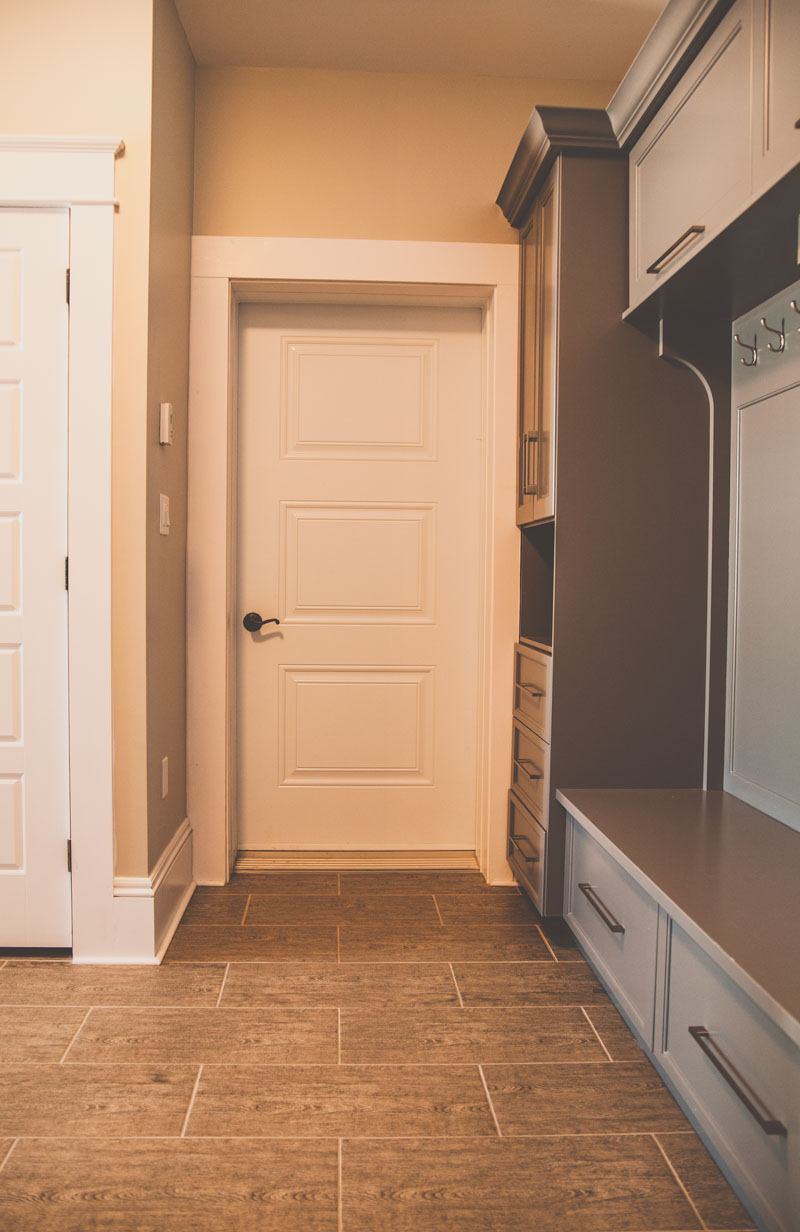 Large built in storage cabinets and bench in the entryway