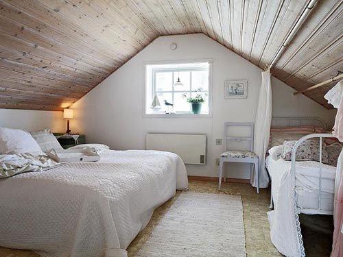 fotografia decoracion atico usado como dormitorio