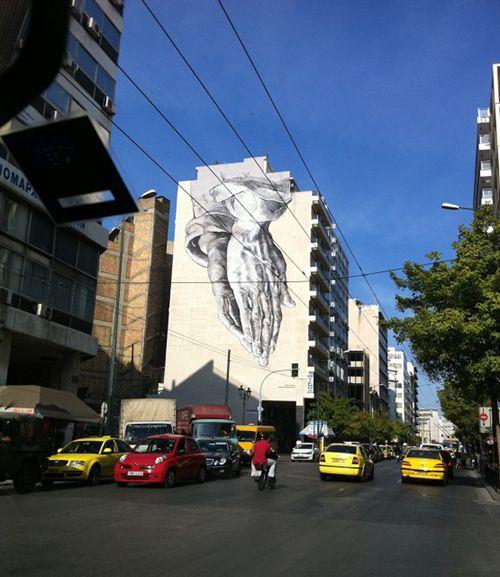 manos graffiti edificio