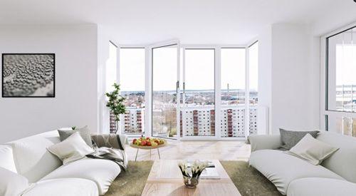 Scandinavian-Apartment-white-living-floor-to-ceiling-windows-600x330