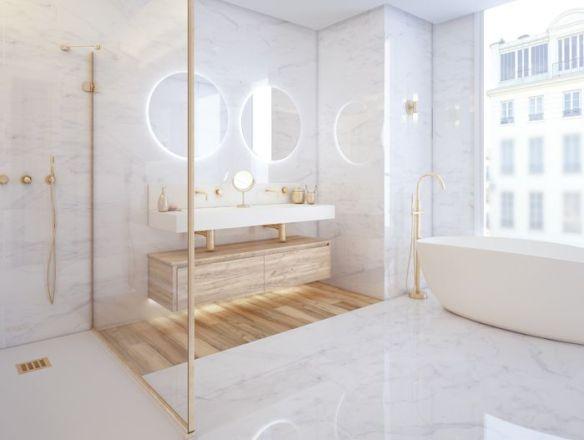 baño con luz natural y luz en espejos redondos maquillaje