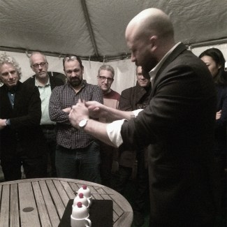 Magician Matt Holtzclaw works miracles with cups and balls.