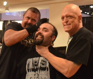 Host Jay K with horror icons Kane Hodder and Michael Berryman