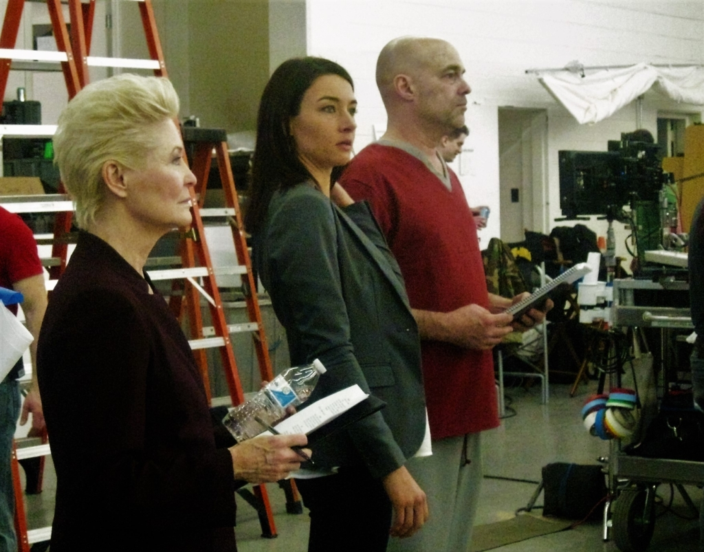 Harrison Smith, Cortney Palm, and Dee Wallace look on as a scene is prepared. Harrison was an extra as a patient in the ward that day!