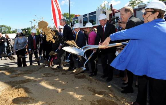 Gov. Charlie Baker, center, and other dignitaries at the groundbreaking ceremony for Mass Bay Community College's Center for Health Sciences, Early Childhood and Human Services, at 490 Franklin St., Framingham, Sept. 29, 2021.