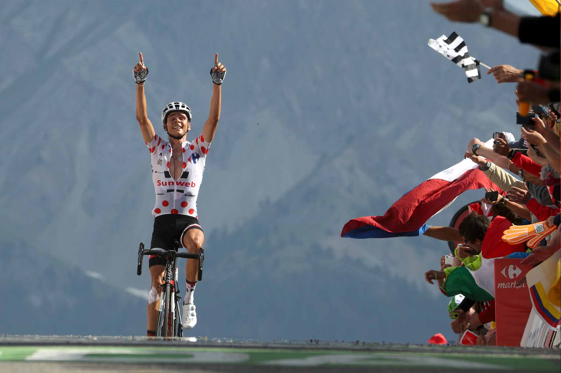 BRIANCON, FRANCE - JULY 20: Warren Barguil of France riding for Team Sunweb celebrates as he wins stage 18 of the 2017 Le Tour de France, a 179.5km stage from Briançon to Izoard on July 20, 2017 in Briancon, France. (Photo by Chris Graythen/Getty Images)