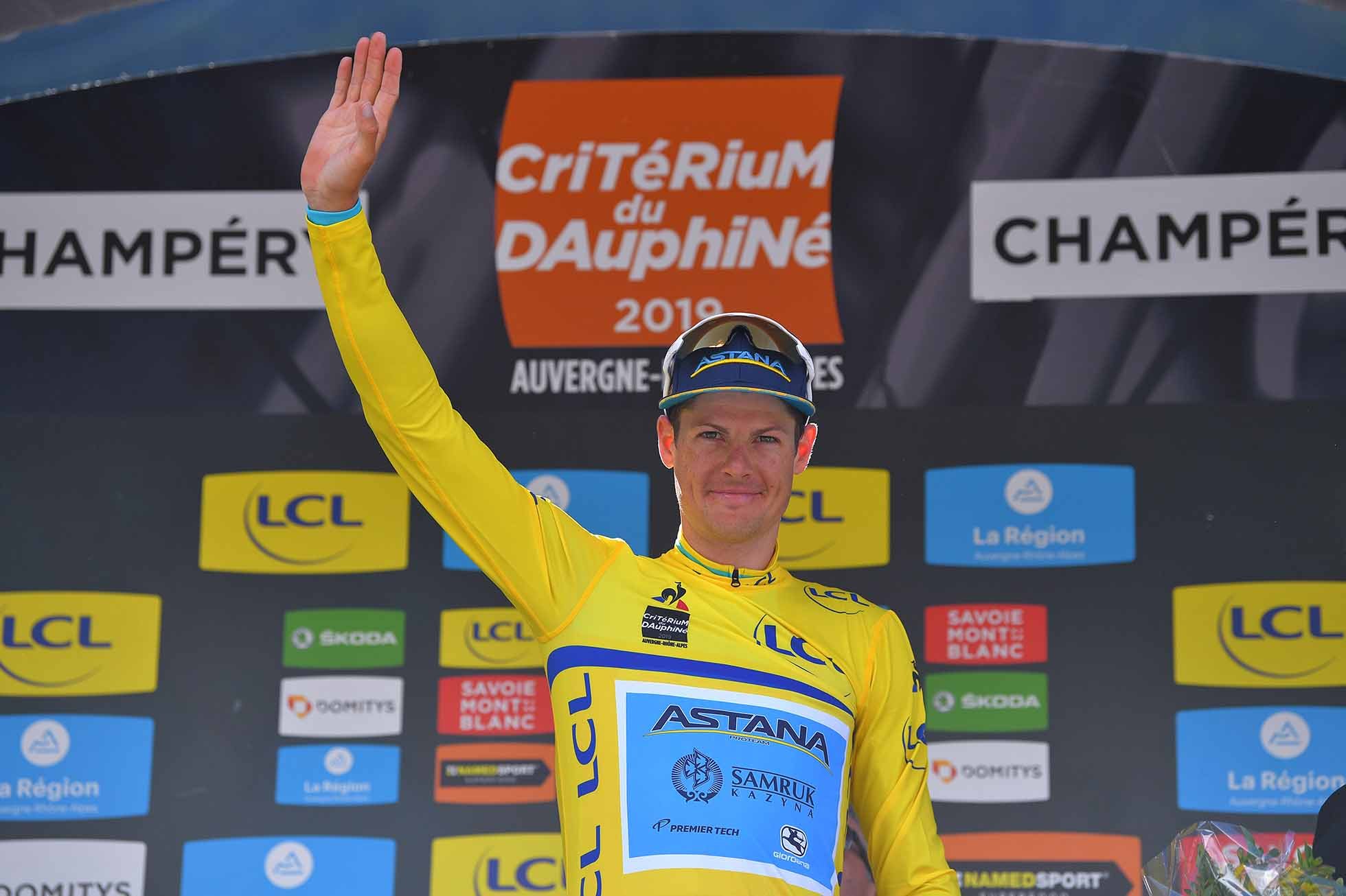 CHAMPÉRY, SWITZERLAND - JUNE 16: Podium / Jakob Fuglsang of Denmark and Astana Pro Team Yellow Leader Jersey / Celebration / during the 71st Criterium du Dauphine 2019, Stage 8 a 113,5km stage from Cluses to Champéry - Montée de Champéry 1036m / #Dauphine / @dauphine / on June 16, 2019 in Champéry, Switzerland. (Photo by Tim de Waele/Getty Images)