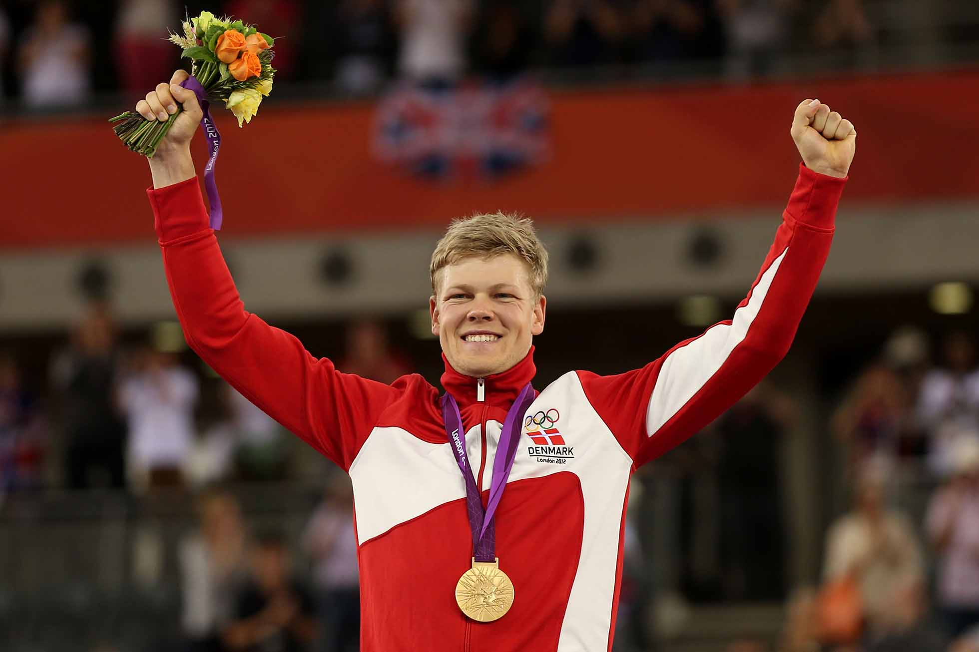 LONDON, ENGLAND - AUGUST 05: Lasse Norman Hansen of Denmark is presented the Gold medal during the medal ceremony for the Men's Omnium Track Cycling on Day 9 of the London 2012 Olympic Games at Velodrome on August 5, 2012 in London, England. (Photo by Bryn Lennon/Getty Images)
