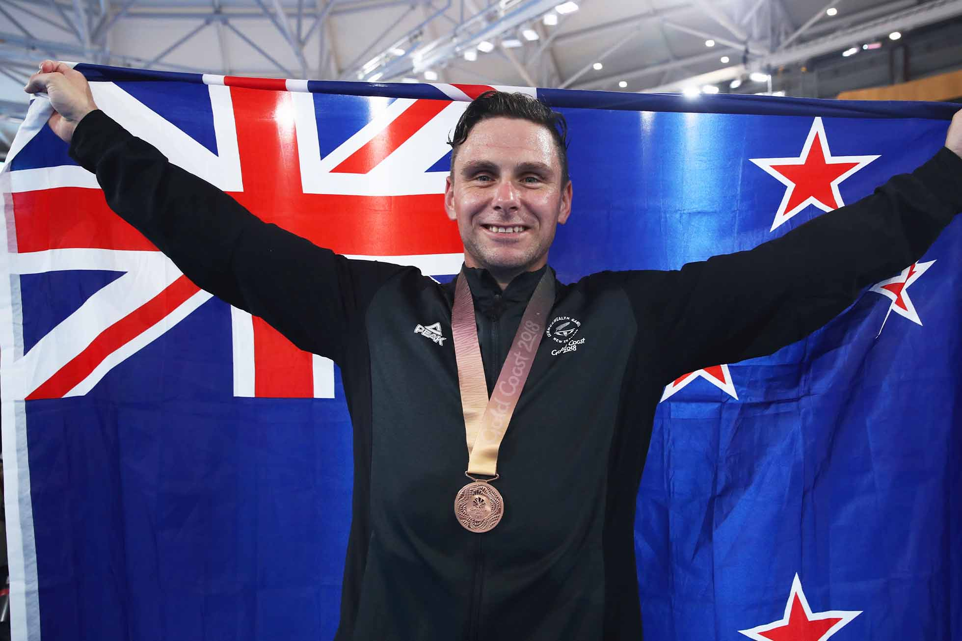 BRISBANE, AUSTRALIA - APRIL 06: Bronze medalist Edward Dawkins of New Zealand celebrates during the medal ceremony for the Men's Keirin Finals on day two of the Gold Coast 2018 Commonwealth Games at Anna Meares Velodrome on April 6, 2018 in Brisbane, Australia. (Photo by Scott Barbour/Getty Images)