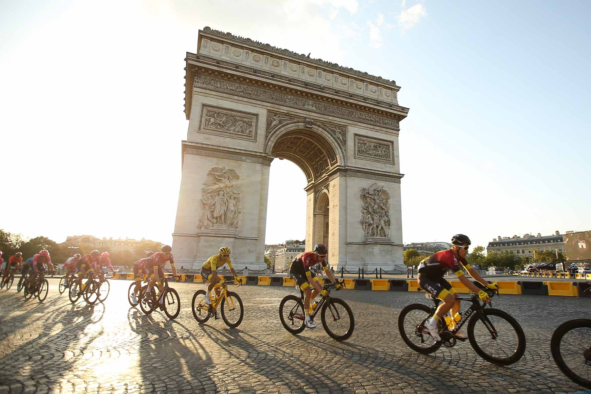 106th Tour de France 2019 - Stage 21 PARIS, FRANCE - JULY 28: Yellow jersey Egan Bernal Gomez of Colombia and Team Ineos passes with the pack in front of Arch of Triumph (Arc de Triomphe) at the top of Avenue des Champs Elysees during stage 21 of the 106th Tour de France 2019, the last stage from Rambouillet to Paris - Champs Elysees (128km) on July 28, 2019 in Paris, France. (Photo by Jean Catuffe/Getty Images)