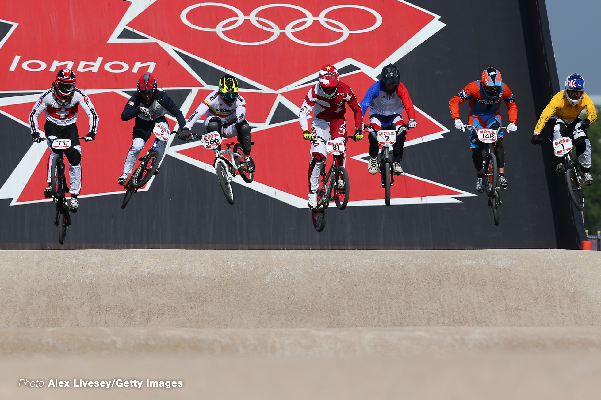 LONDON, ENGLAND - AUGUST 10: The field race down the starting ramp in the Men's BMX Cycling Final on Day 14 of the London 2012 Olympic Games at the BMX Track on August 10, 2012 in London, England. (Photo by Alex Livesey/Getty Images)