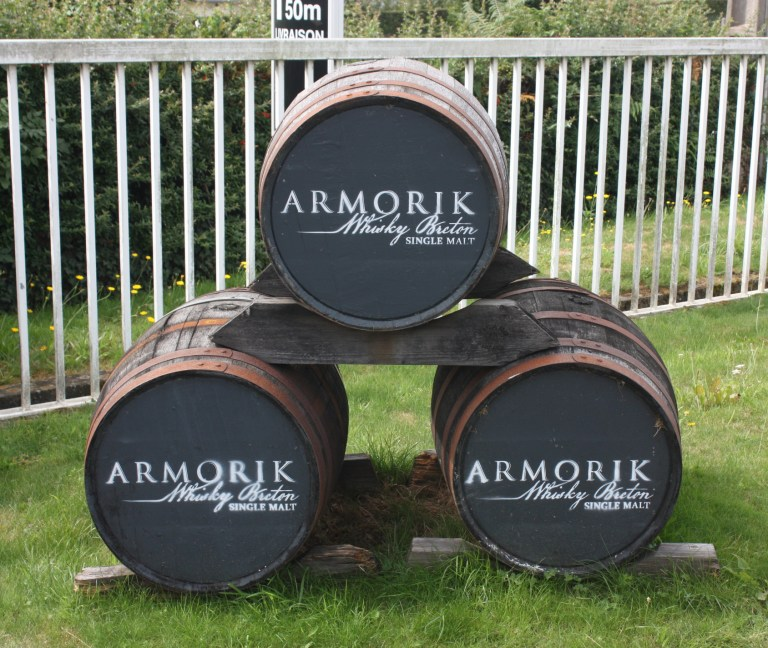 Decorative casks at the entrance of Warenghem Distillery