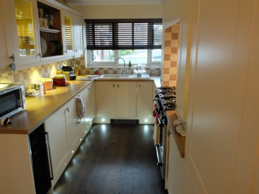 cream kitchen with floor spotlights