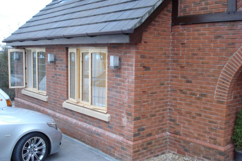 Feature Stepped Brickwork with hardwood windows
