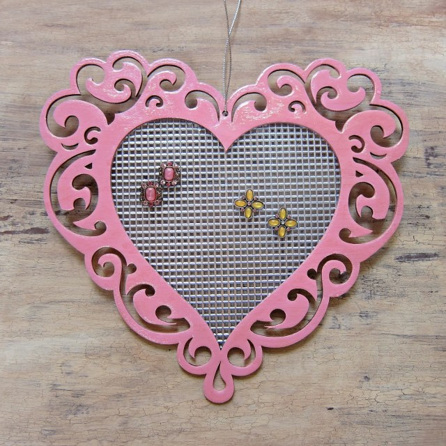 Use plastic canvas and an unfinished frame to make a pretty jewelry organizer.