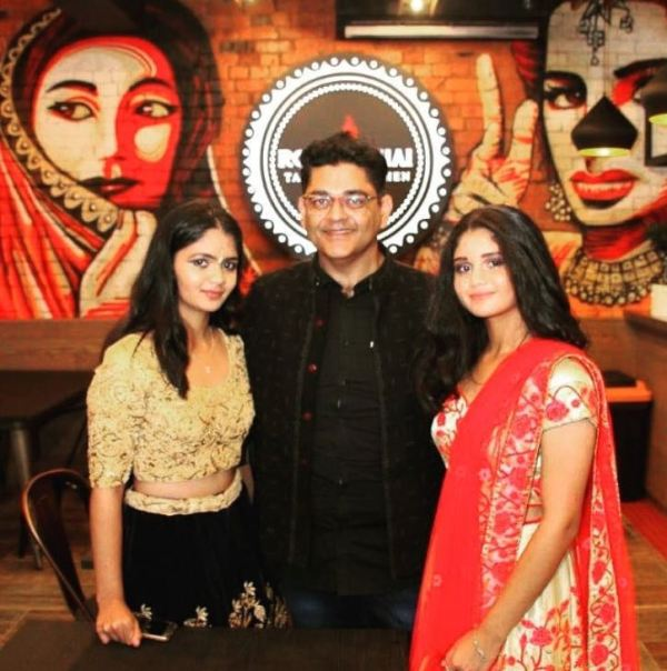 Roti and Chai owner and his daughters