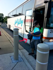 The red arrow points to S's backpack, as he rushes up to get on board!