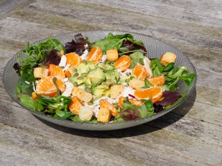 Salad with chicken, tangerines and avocado
