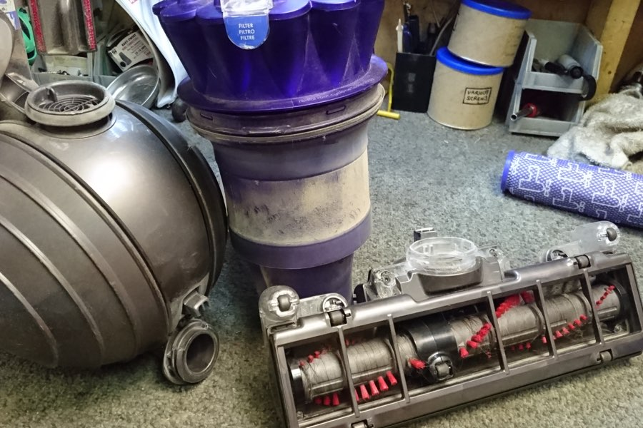 Disassembled Dyson vacuum. Dyson vacuum repair
