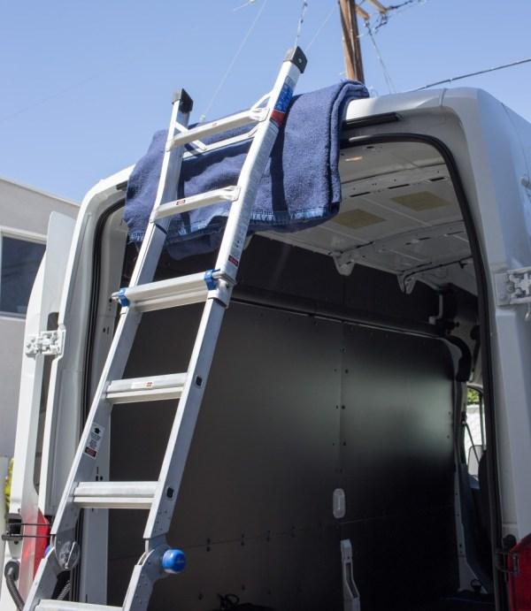 Ladder leaning against roof of van