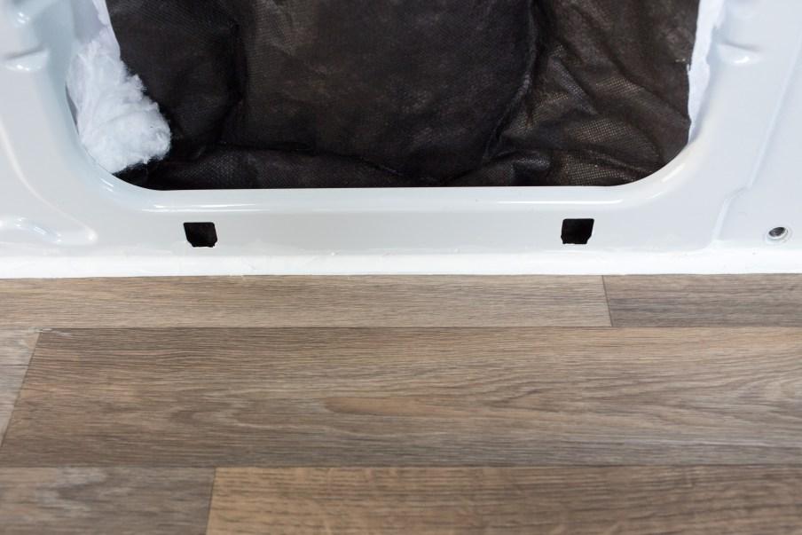 Finished edge with white caulk