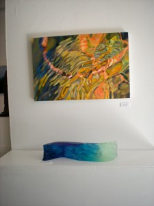 """This piece, Riverflow, probably took the """"most petted"""" award. It's sitting below my favorite Leah Wilson painting in the show."""