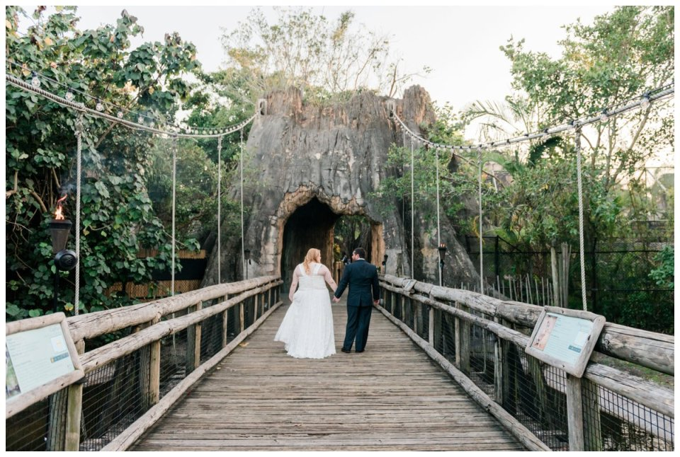 bride and groom portraits on bridge at palm beach zoo wedding